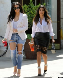 Kim and Kourtney Kardashian in cut out clothes at Starbucks in Calabasas